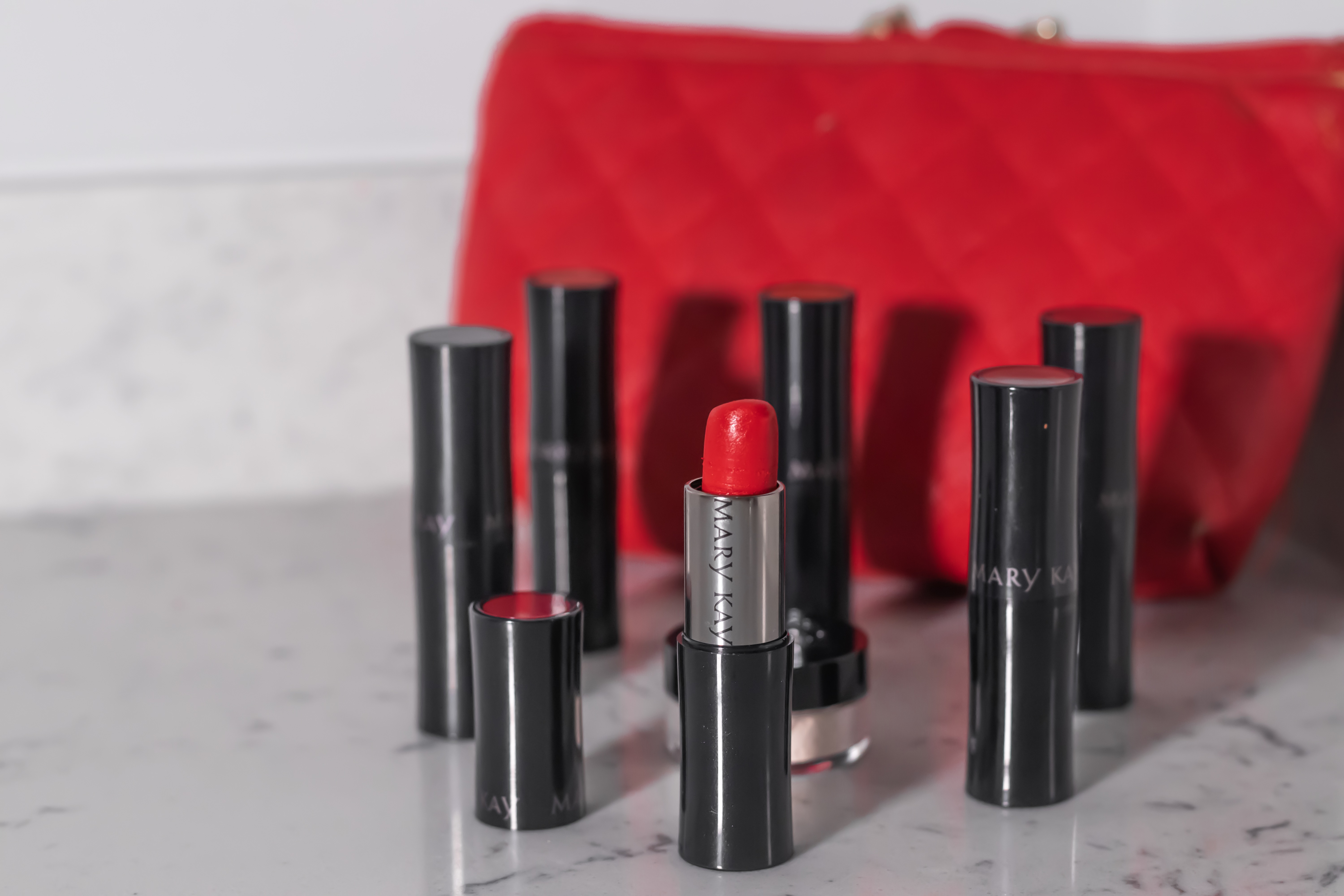 Red Lipstick on the Counter with a Red Bag